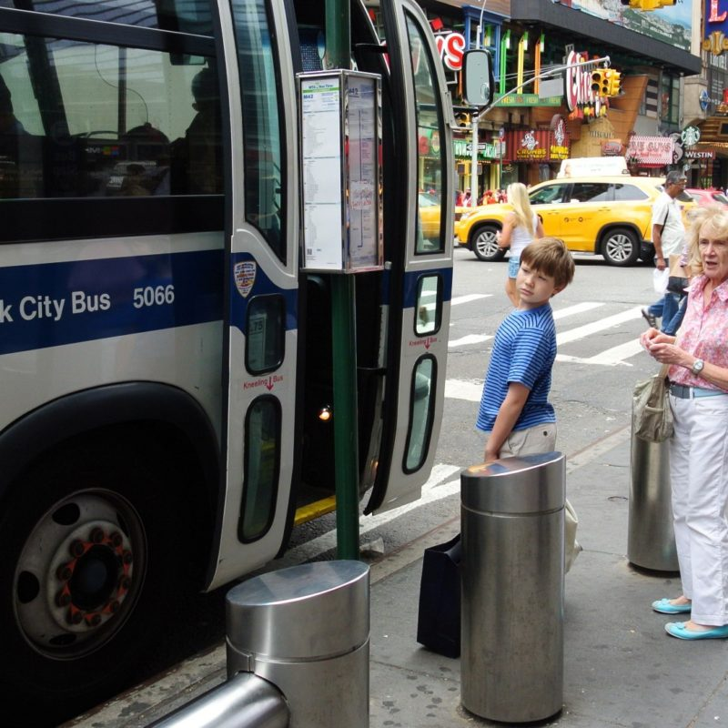 Boarding a bus in New York. © Catherine Carr, 2015.