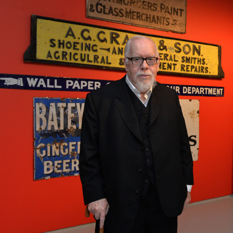 Artist Peter Blake with his exhibit at the opening night of the Barbican Gallery's 'Magnificent Obsessions: The Artist as Collector' on 11th February 2015.