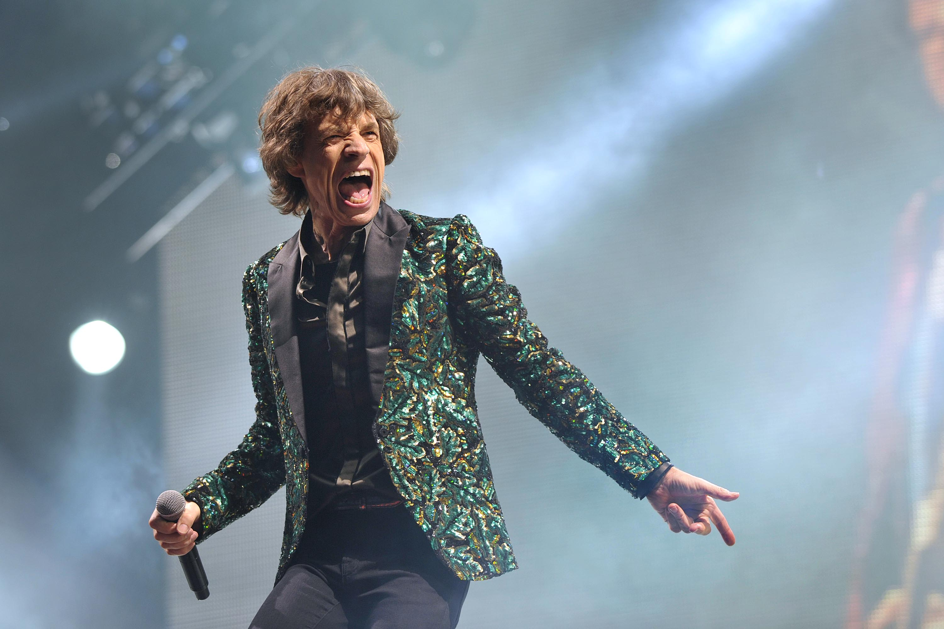 Mick Jagger performing with the Rolling Stones at Glastonbury 2013. Photographer: Sarah Jeynes. © BBC.