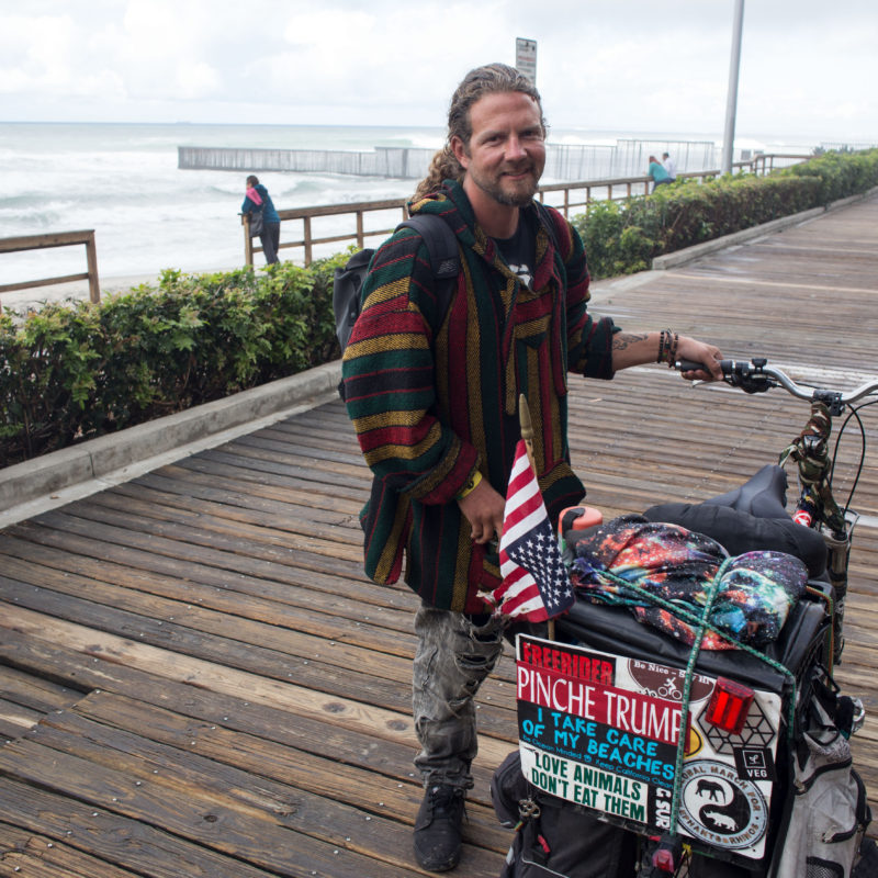 'I'm cycling to Peru' - photographed near the US/Mexico border at Tijuana. © Paul Jay, 2016