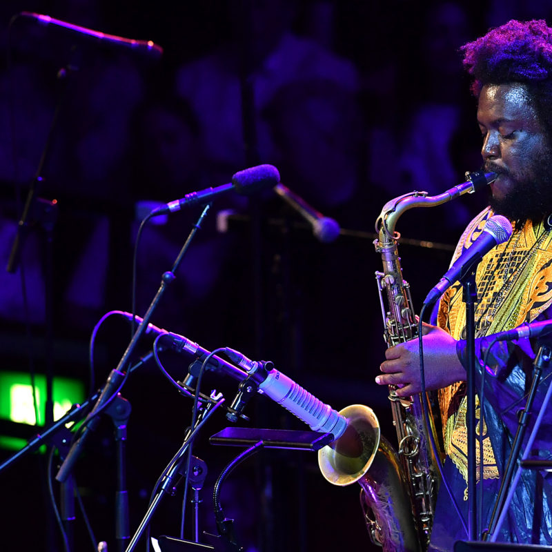 Prom 61: Late Night Prom featuring Kamasi Washington on saxophone with the strings of the City of Birmingham Symphony Orchestra, conducted by Jules Buckley, at the Royal Albert Hall on 30th August 2016.