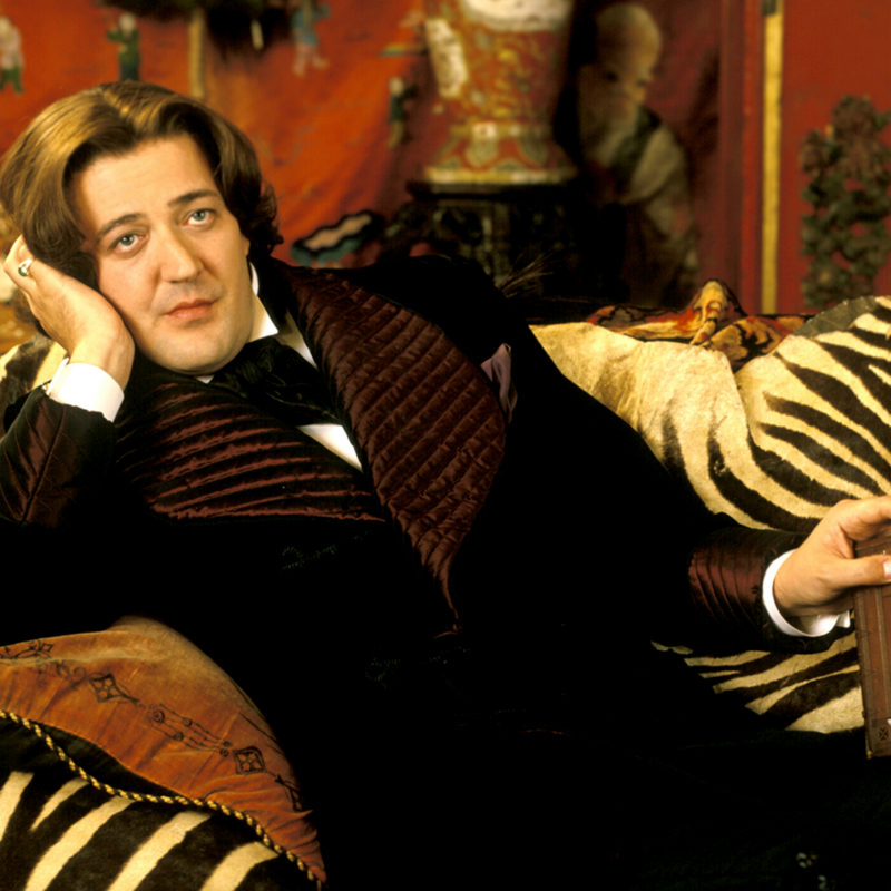 Stephen Fry on set as Oscar Wilde from the film Wilde, 1997. Photographer: Liam Daniel.